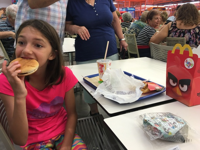 It didn't happen for us until the last day of our trip, but we finally found a Kosher McDonalds for Zoe. She is seen here eating her first Kosher kids meal burger.